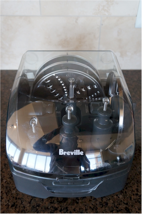 The Breville comes with an array of blade/disc attachments.
