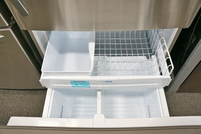 The freezer has two drawers for storing food and a factory-installed automatic icemaker.