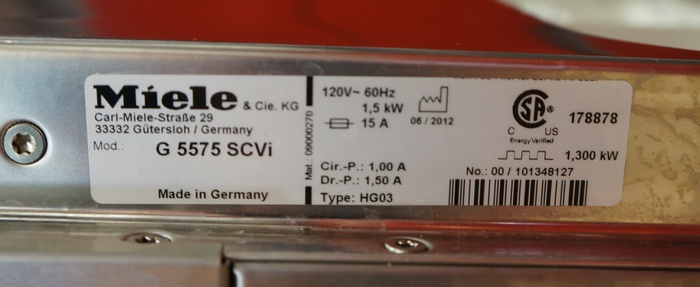 The model number information is located on the side of the Miele G 5575 SC's door.