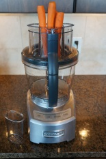 Continuously processing carrots through the small feeder tube.