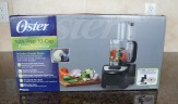 Unpacking the Oster Total Prep 10-Cup Food Processor.